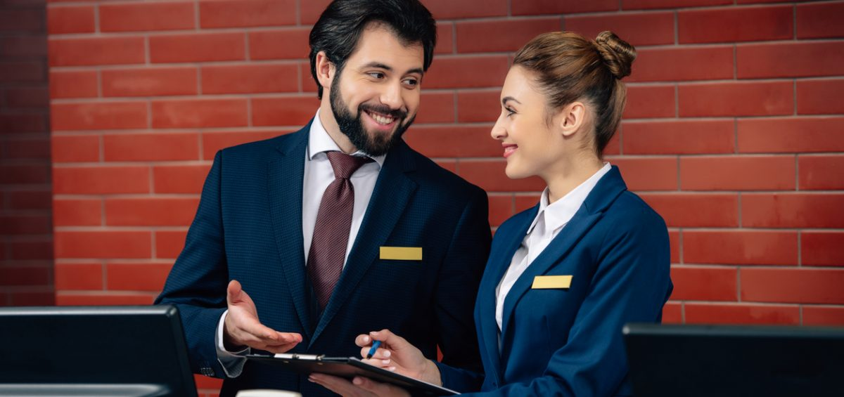 smiling hotel receptionists working together
